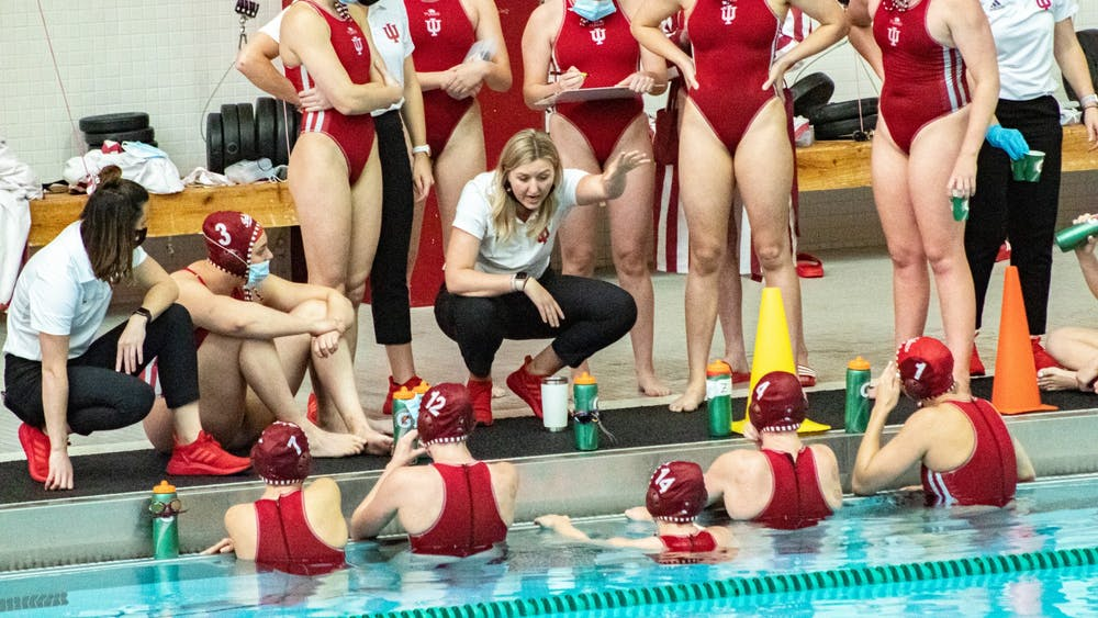 Head coach Taylor Dodson talks to the Hoosiers prior to their April 13 Water Polo match against the University of California at Los Angeles. The Hoosiers lost both of their matches against UCLA Monday and Tuesday.