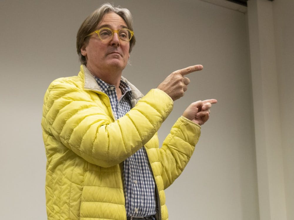 Professor T. Kelly Wilson speaks to an audience on his life and architectural influences Nov. 11 at the Fine Arts building. Wilson graduated with a master's in architecture from Harvard University.