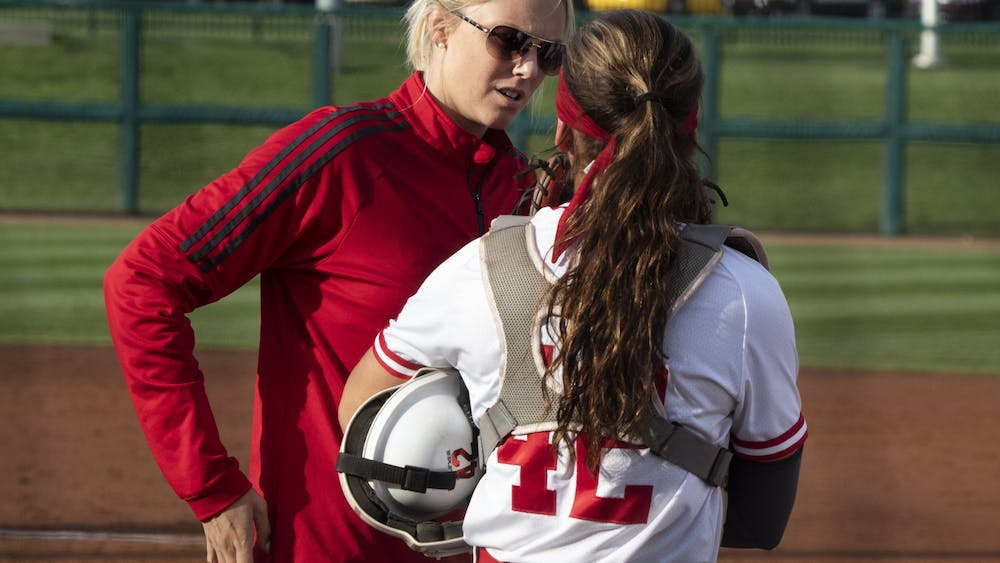 IU softball Associate Coach Chanda Bell talks to catcher Bella Norton after the third out April 10, 2019, during the first game against Purdue. IU went 1-3 during the Big Ten/ACC Challenge Feb. 14-16 in Durham, North Carolina.