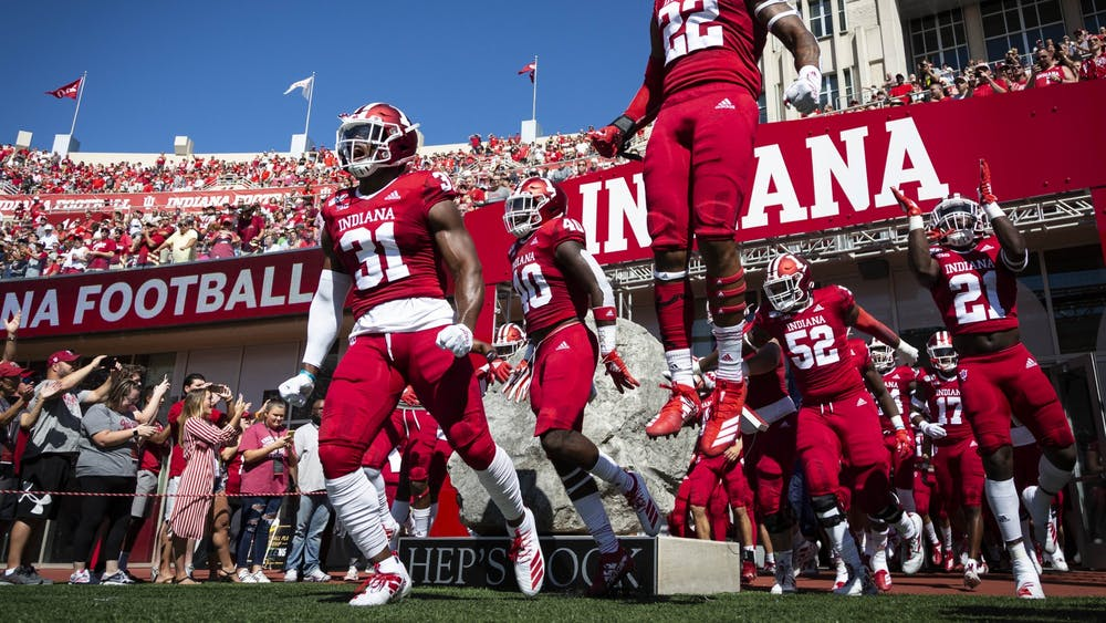 IU football players take the field at the start of the game against Ohio State on Sept. 14 at Memorial Stadium. IU football spring practices have already begun, and the 2021-22 season will start Sep. 4.
