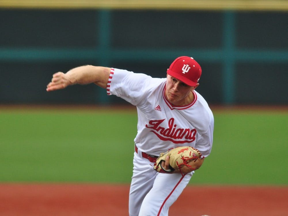 Sophomore pitcher Jonathan Stiever pitches against Minnesota at Bart Kaufman Field on Friday. IU lost 11-0.
