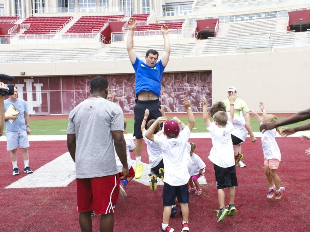 Andrew Luck demonstrating how to preform a jumping exercise to children during the Change the Play event Tuesday in Bloomington.