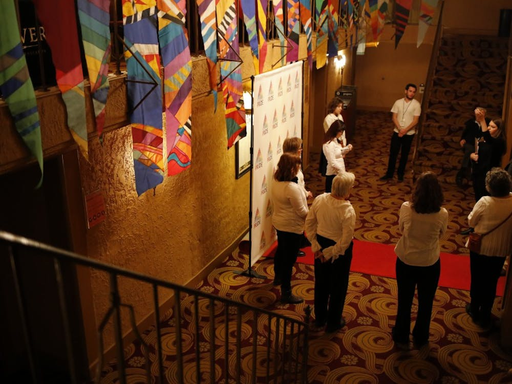 Volunteer ushers are briefed by the house manager, Anna Kosatka, before the Buskirk-Chumley Theater opened for the first night of the PRIDE Film Festival in 2015. The 16th annual festival will take place January 25–27.