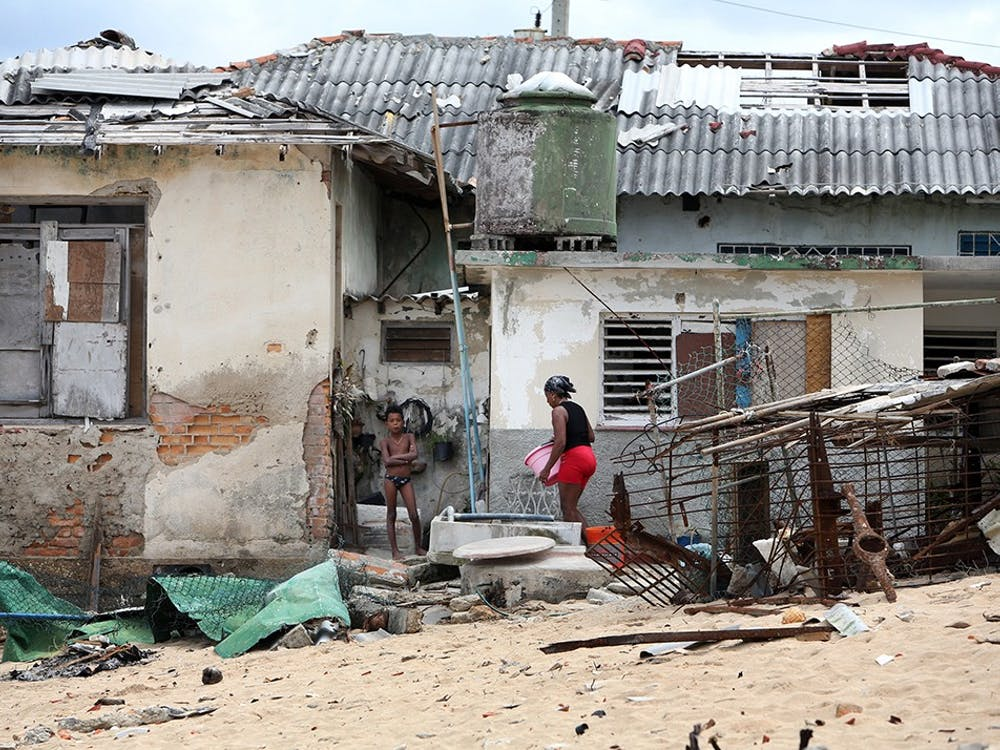Residents of the small, seaside town of Jaimanitas, work outside of their heavily damaged home Thursday Sept. 28. Many seaside homes in the town were severely damaged by the outer bands of Hurricane Irma.