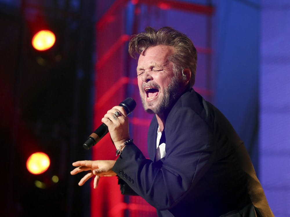 """John Mellencamp performs during Farm Aid 30 on Sept. 19, 2015, at the FirstMerit Bank Pavilion in Chicago. Mellencamp and Bruce Springsteen released the single """"Wasted Days"""" on Wednesday."""