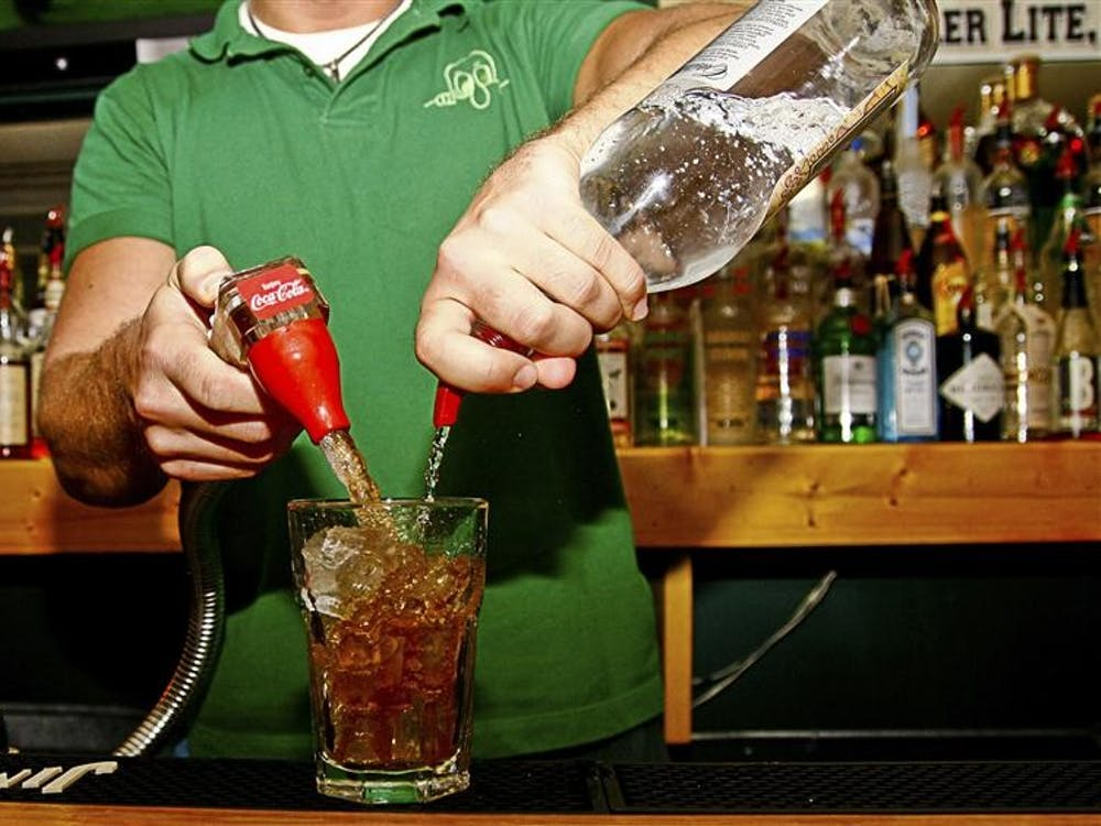 A bartender makes a drink at Kilroy's Bar and Grill on Kirkwood Ave.