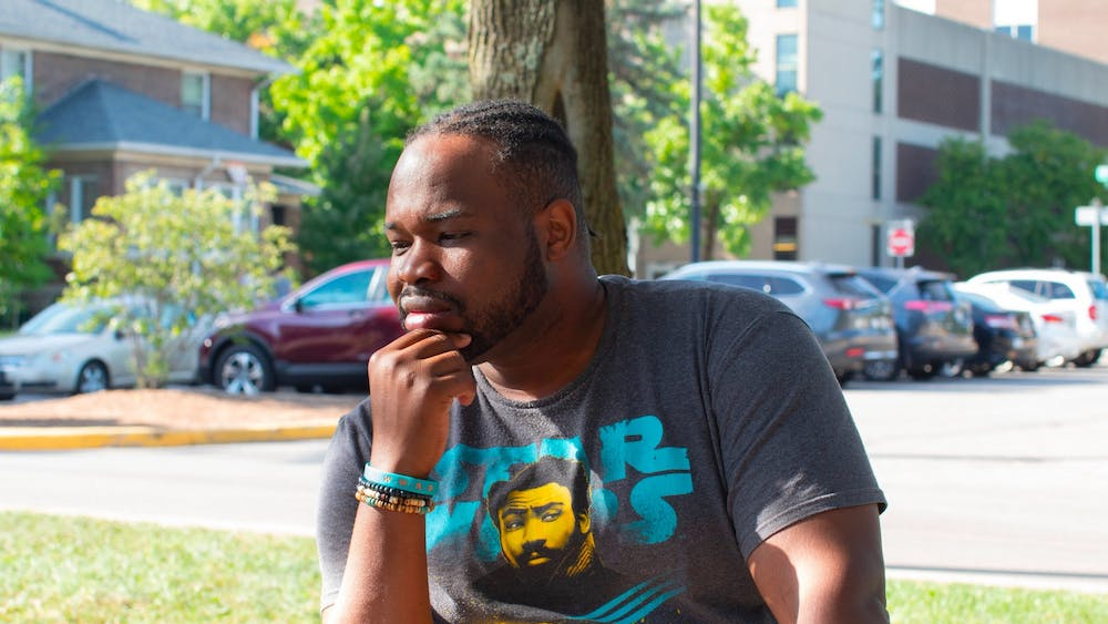 """Vauhxx Booker talks about his past as an activist Sept. 4 in People's Park. After being """"almost the victim of an attempted lynching"""" July 4, Booker said he is in the eye of the storm as he waits for the next step to begin after his alleged attackers were charged."""