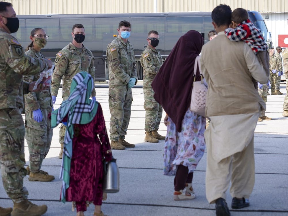 Afghan evacuees arrive in Indianapolis Thursday, Sept. 2, 2021, as 1st Cavalry Division soldiers watch. Exodus Refugee Immigration will open a Bloomington office, which will help refugees get settled in their new community.