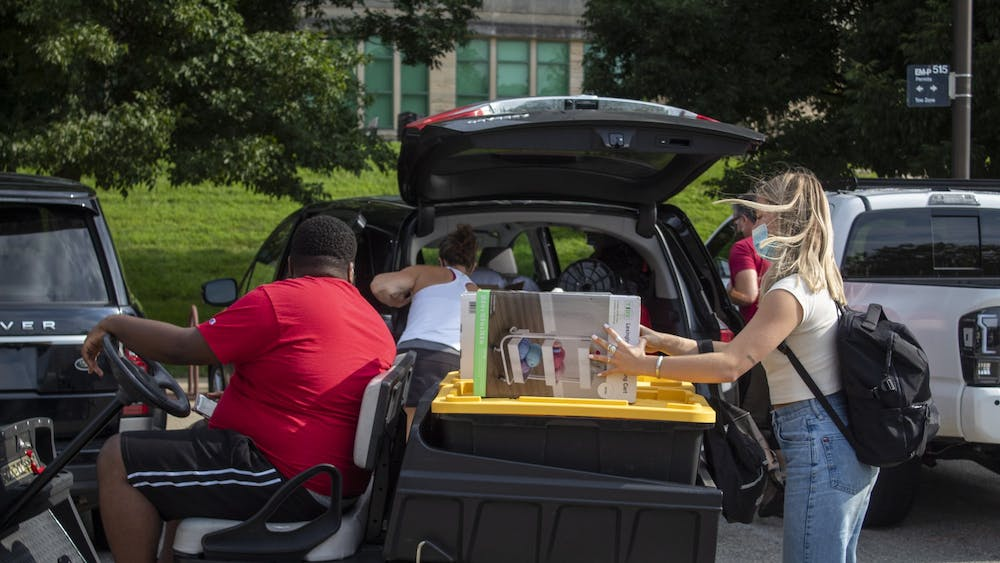 A student loads her belongings onto a trailer during move-in Aug. 18, 2020, outside of Eigenmann Hall. IU in-person classes begin Feb. 8.
