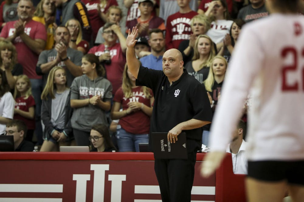 IU volleyball head coach Steve Aird gives instruction from the sideline during Sept. 28, 2018 against Minnesota at University Gym.