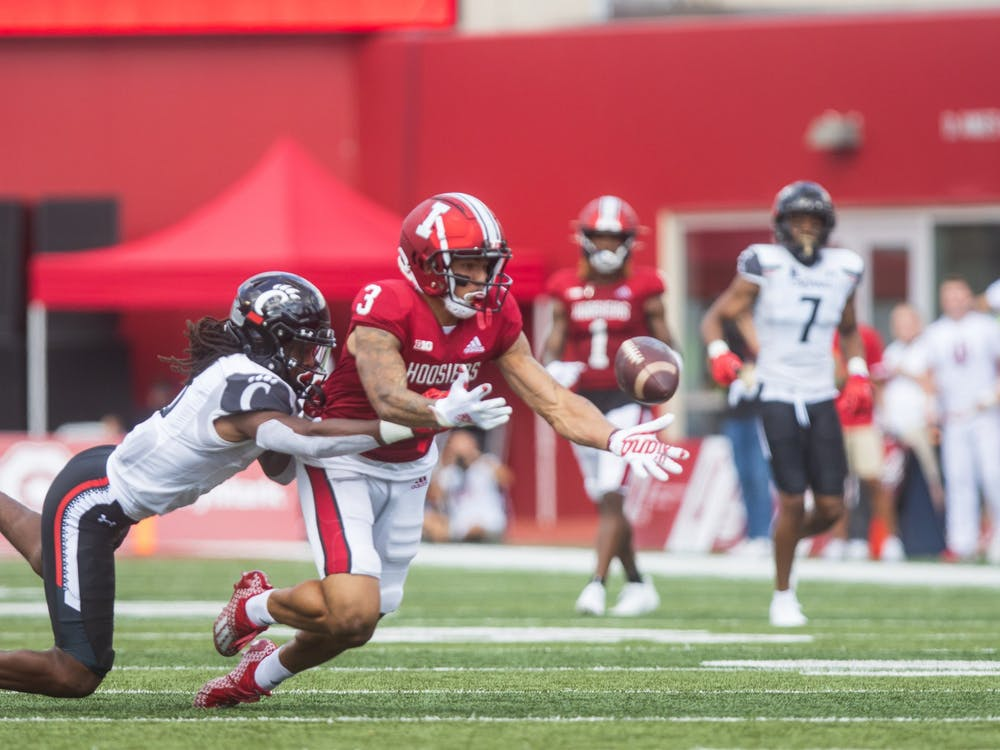 Senior wide reciever Ty Fryfogle attempts to dive for the catch Sept. 18, 2021, at Memorial Stadium. Indiana will play Ohio State at 7:30 p.m. Saturday in Bloomington.