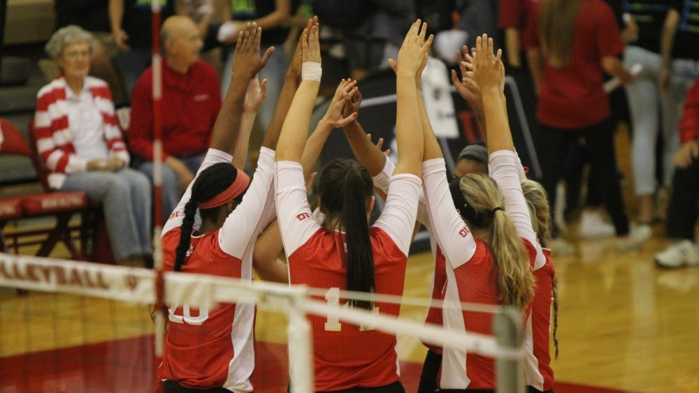 Members of the IU women's volleyball team huddle during the Hoosiers' game against Bowling Green on Saturday. IU swept the Indiana Invitational.