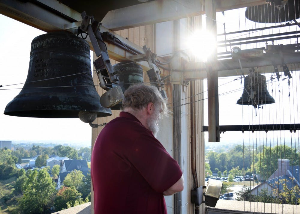 Guest carillonneur John Gouwens gives a small tour of the bell tower at the top of the Arthur R. Metz Memorial Carillon on Sept. 23. There are about 600 carillons worldwide, with about 60 of them on universities and colleges in the United States.