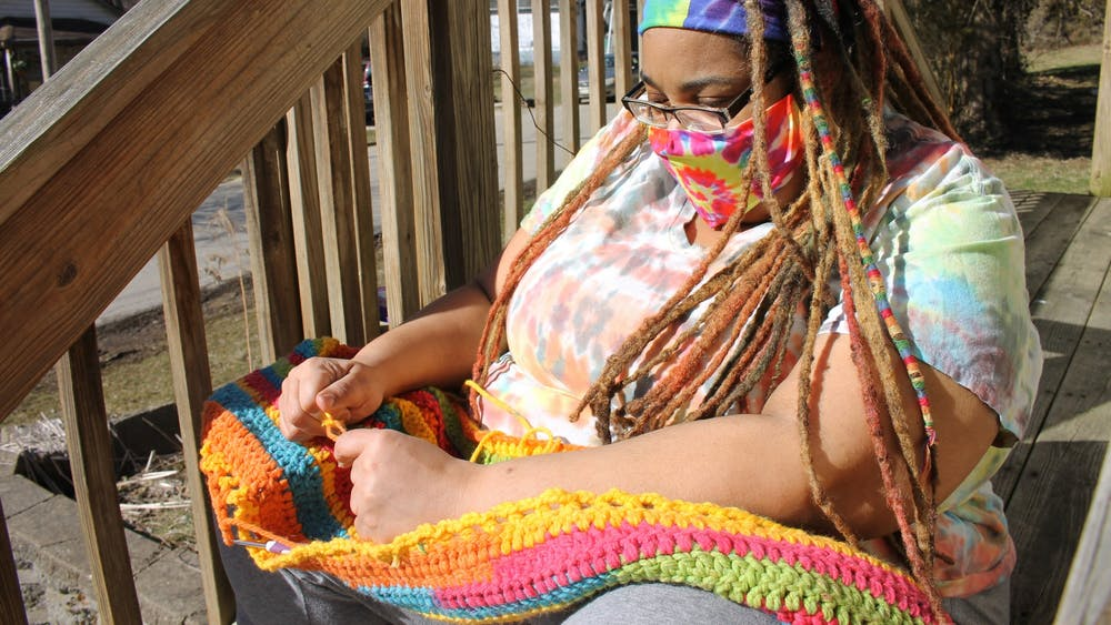 Kamala Brown-Sparks, an IU alumna with two children currently at IU, crochets her first blanket for her new Blankets for B-Town Project. She launched Blackhippiechick's Blankets for B-Town on Feb. 19 to provide warmth to the local unhoused community with her crocheted blankets.
