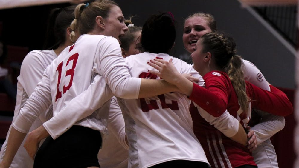 IU celebrates a crucial point against Northwestern on Oct. 5 at Wilkinson Hall. The Hoosiers overpowered the Wildcats, 3-1.