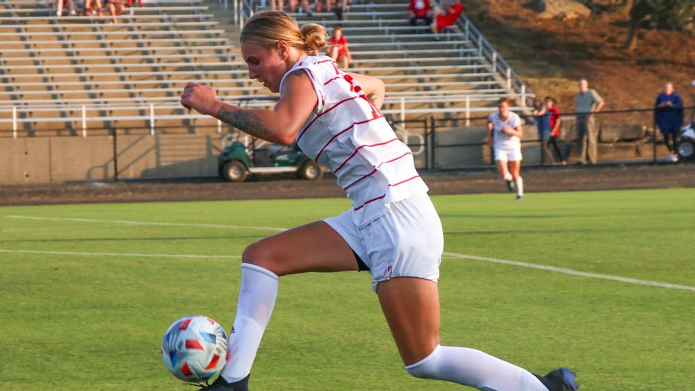 Senior defender Oliwia Wos posesses the ball in game against the Valparaiso University Beacons Thursday in Bill Armstrong Stadium. IU has not yet allowed a goal through the first two games of the 2021 season.