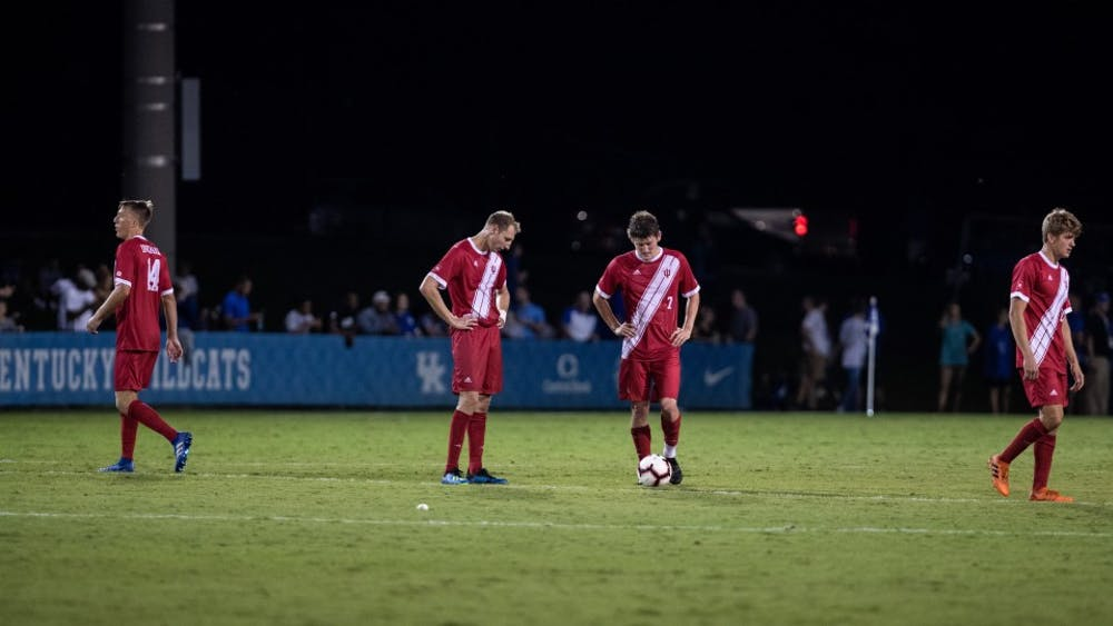 Sophomore defender A.J. Palazzolo, center left, and senior midfielder Trevor Swartz, center right, react after Kentucky scored their third goal of the night Oct. 3, in Lexington, Kentucky. IU lost 3-0, ending their nine-game winning streak.