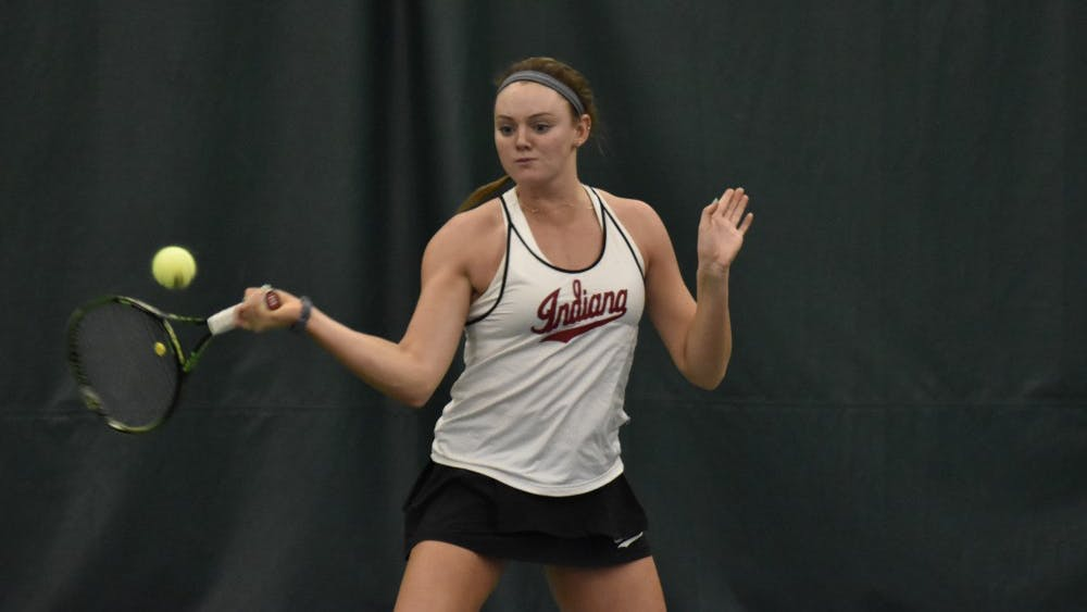 Redshirt sophomore Caitlin Bernard swings through a forehand during her singles win over Eastern Illinois University. IU improved to 8-0 after their win over EIU on Feb. 9.
