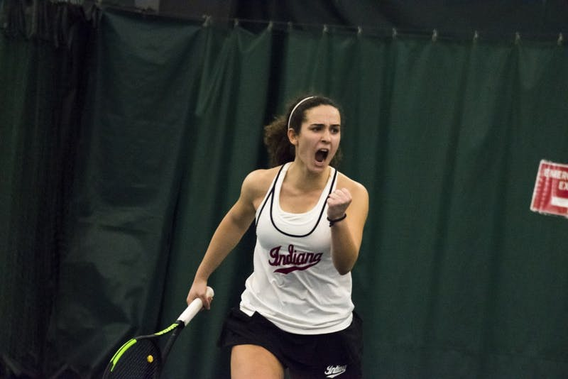 Then-freshman, now sophomore, Jelly Bozovic celebrates winning a point during her win March 3 over Miami University. Bozovic went 3-0 in singles play at the Western Michigan Super Challenge this past weekend.