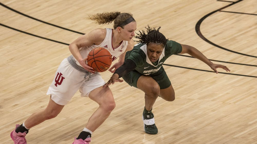 Junior guard Grace Berger dribbles around a defender Thursday in the quarterfinals of the Big Ten women's basketball tournament at Bankers Life Fieldhouse in Indianapolis. Berger scored a team-high 19 points in No. 2 seed IU's 69-61 loss to No. 7 seed Michigan State.