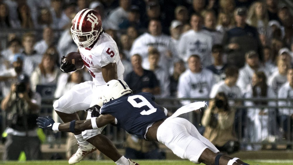 Graduate running back Stephen Carr attempts to elude a tackler against Penn State on Oct. 2, 2021, at Beaver Stadium. Indiana lost to Penn State 24-0.
