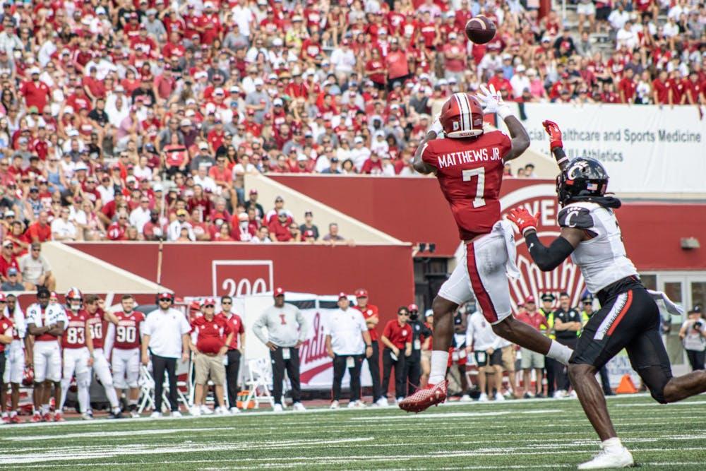 <p>Graduate wide receiver D.J. Matthews Jr. leaps for a catch against the University of Cincinnati on Sept. 18, 2021, at Memorial Stadium. Indiana lost to Cincinnati 38-24.</p>