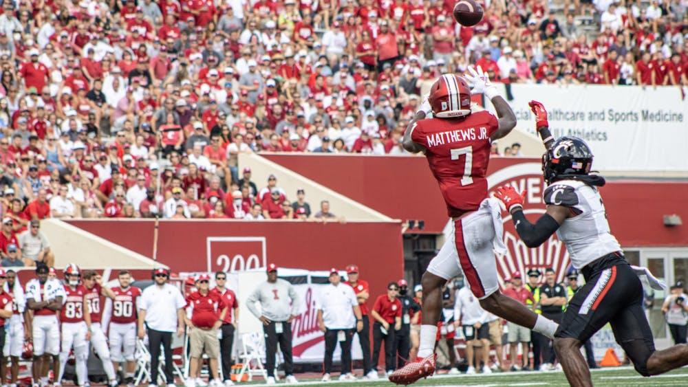 Graduate wide receiver D.J. Matthews Jr. leaps for a catch against the University of Cincinnati on Sept. 18, 2021, at Memorial Stadium. Indiana lost to Cincinnati 38-24.