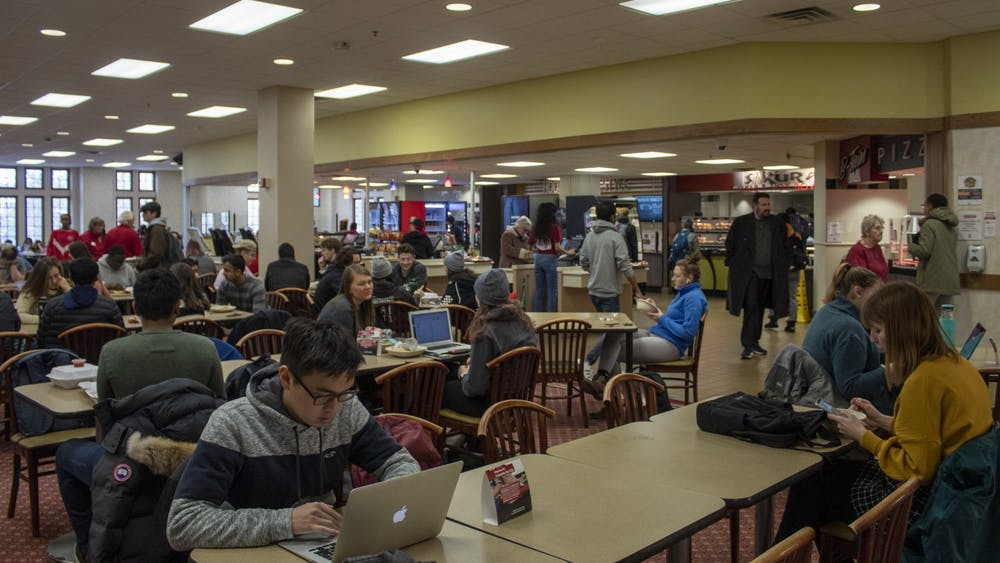 Students sit in the lobby of a dining area Dec. 10 in the Indiana Memorial Union.  The IMU will periodically close eating establishments Dec. 7-23 to prepare for renovations beginning next month.
