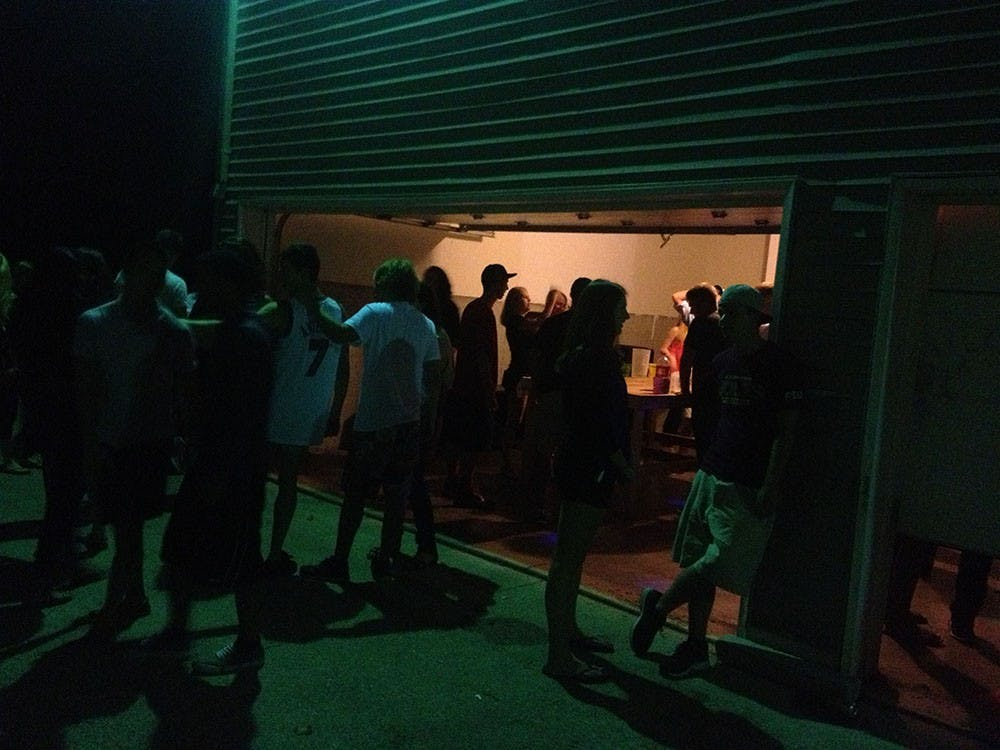 Students drink and socialize at a house party near the Indiana University Bloomington campus. Indiana law dictates that consent for sex cannot be given if one or more of the individuals is under the influence of alcohol or drugs.