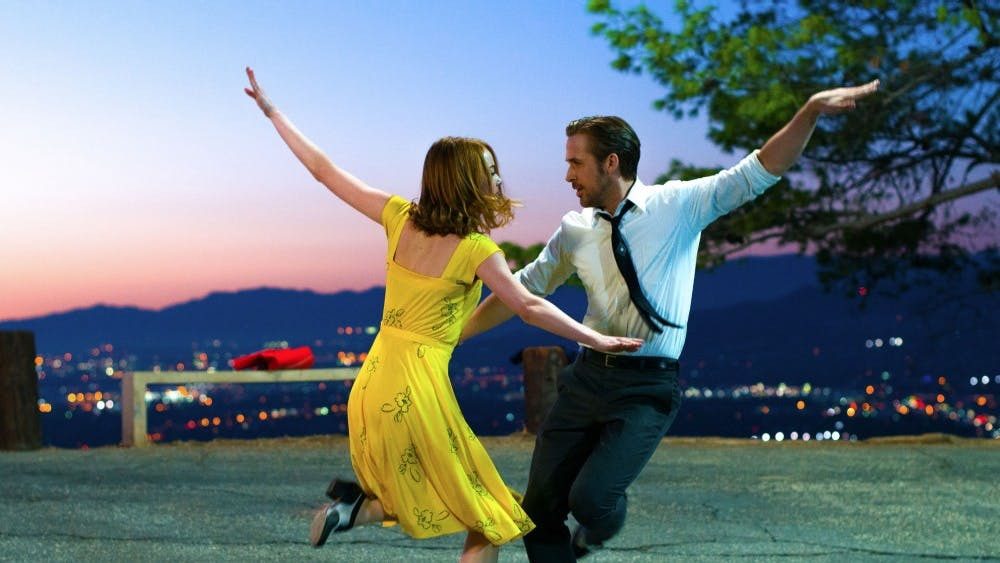 """Ryan Gosling as Sebastian and Emma Stone as Mia in a scene from the movie """"La La Land,"""" which was nominated for a record-tying 14 Oscars. (Dale Robinette/Lionsgate/TNS)"""