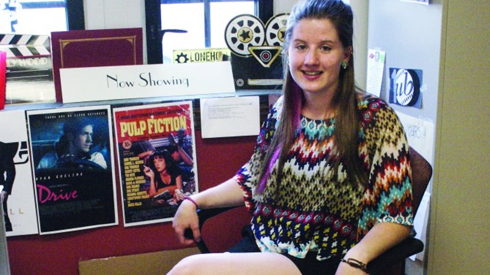 Greta Smith poses for us while situated in her nook of the Union Board Office.