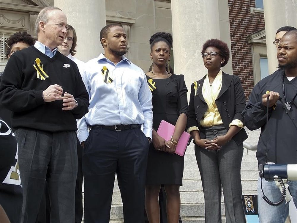 Purdue University president Mitch Daniels speaks to the crowd after his meeting with the Purdue Anti-Racism Coalition leaders Friday on the steps of Hovde Hall at the school.