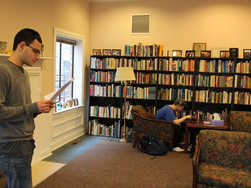 Freshman Abe Shapiro and sophomore Jordan Schiff complete homework and spend time together in the Helene G. SimonHillel Center on campus.