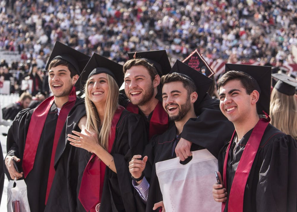 <p>Members of the graduating class of 2018 pose for a group picture before the start of the undergraduate commencement May 5, 2018, in Memorial Stadium.<strong> </strong>IU's deal with Herff Jones is making cap and gown costs higher for students compared to other Indiana colleges.</p><p><br/></p>