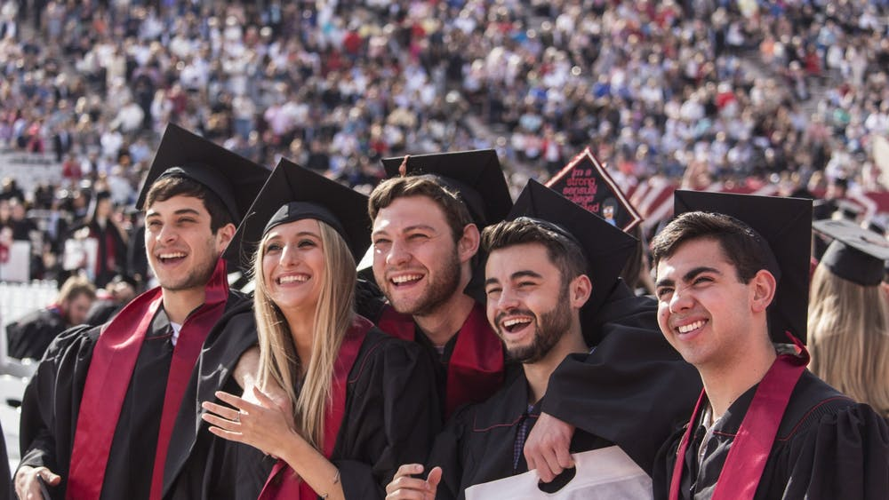 Members of the graduating class of 2018 pose for a group picture before the start of the undergraduate commencement May 5, 2018, in Memorial Stadium. IU's deal with Herff Jones is making cap and gown costs higher for students compared to other Indiana colleges.