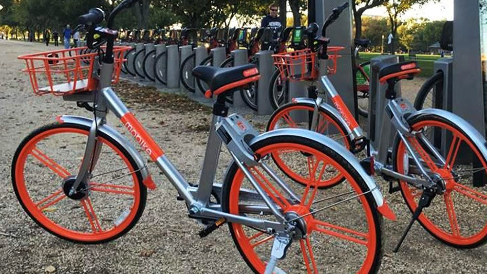 Dock-less bikes park next to a docking station for Capital Bikeshare, in Washington, D.C. Bloomington city officials will work with South Bend, the first city to implement a dock-less bikeshare program in Indiana, as it works to create a bikeshare program in Bloomington.