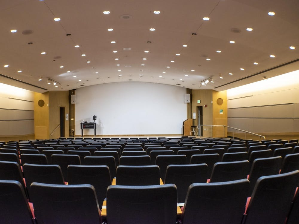 Lights shine on rows of empty seats Sept. 20 in a lecture hall in the Fine Arts Building. A recent study conducted by IU researchers found that students who took more in-person credit hours were less likely to test positive for COVID-19 than other students with less in-person credit hours.