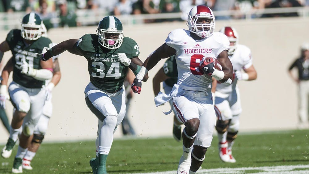 Then-sophomore running back Tevin Coleman runs for a touchdown during IU's game against Michigan State on Oct. 12, 2013, at Spartan Stadium.