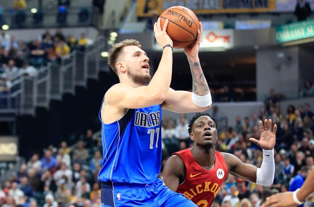f2059e6d7d9 Dallas Mavericks player Luka Doncic puts up a shot against the Indiana  Pacers on Jan. 19 at Bankers Life Fieldhouse in Indianapolis. Tribune News  Service ...