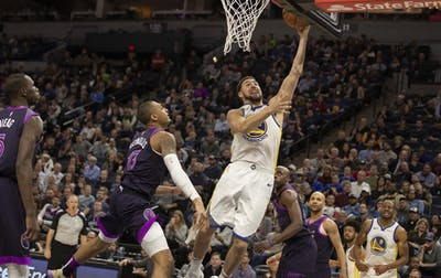 The Golden State Warriors' Klay Thompson scores over the Minnesota Timberwolves' Cameron Reynolds at Target Center in Minneapolis on March 19. The Warriors won, 117-107.
