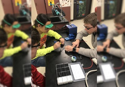 Students Andrew Labban, Joy Bhattacharya and Skyler Parrish work on a drone in 2018 in Bloomington High School North. Labban and Bhattacharya are in a drone club together.