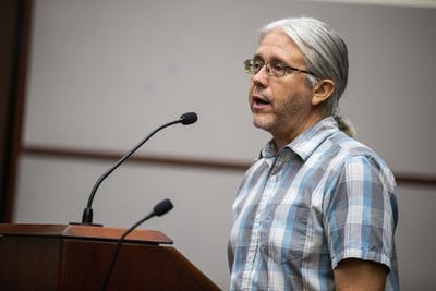 Steve Cotter, natural resources manager for the Bloomington Parks and Recreation Department, talks about the deer population during a hearing over a proposed deer hunting amendment Sept. 19 in City Hall.