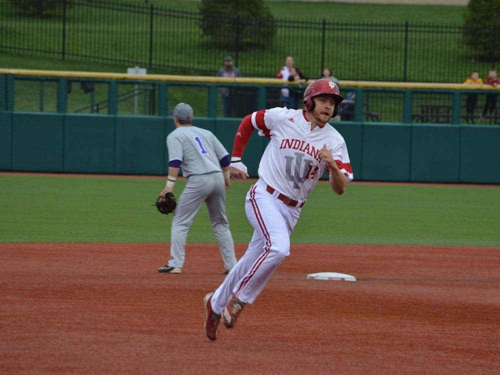 Then-sophomore infielder Matt Lloyd, now-junior, runs to third base after his teammate, Tony Butler, hit a grounder to left field during the 2017 season. Lloyd was named a second team All-American on Thursday.