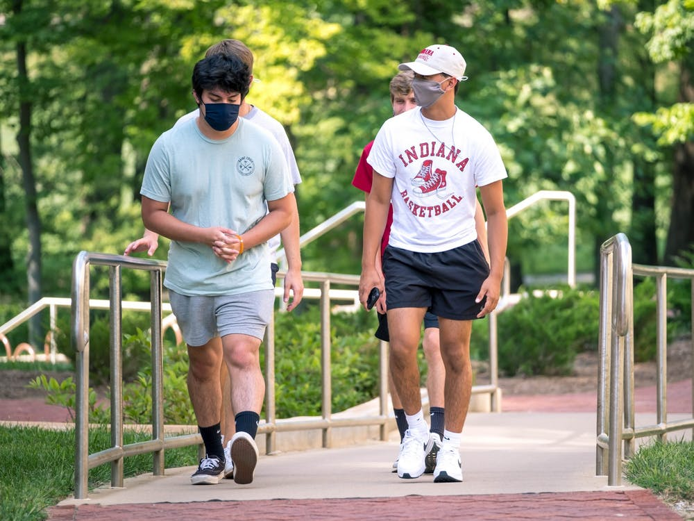 Freshmen students walk through IU to order Starbucks on Aug. 24. The friend group wore their masks together. IU announced Tuesday that mask wearing will be optional for fully vaccinated individuals on all IU campuses effective immediately.