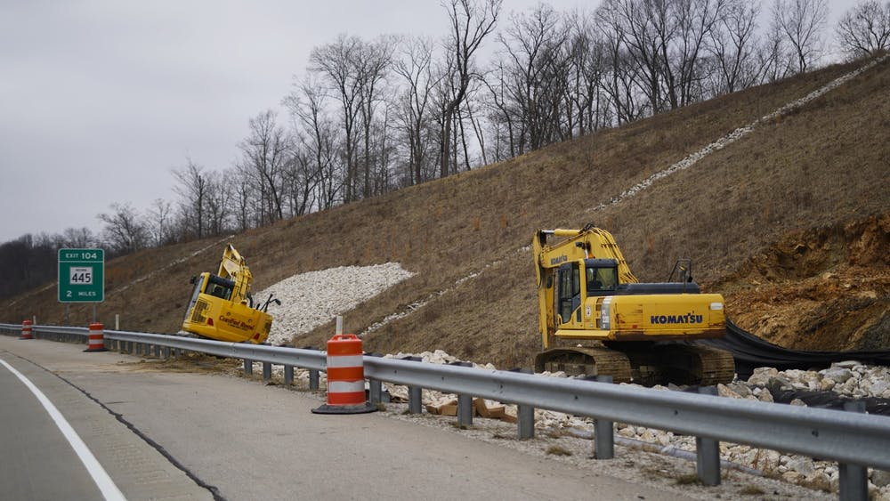 Two pieces of construction equipment sit Jan. 19 on the side of Interstate 69.