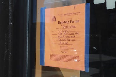 A building permit for the new Five Guys restaurant hangs in the window Sept. 23 at 425 E. Kirkwood Ave.
