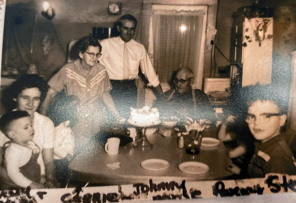The Stancombe family sits around the dining table in the 1950s. Steve Stancombe, far right, can be seen wearing glasses and looking at the camera.