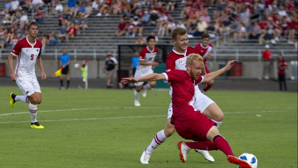Senior defender Simon Waever kicks the ball away from his opponent Sept. 20 at Bill Armstrong Stadium. IU defeated Wisconsin, 3-1.