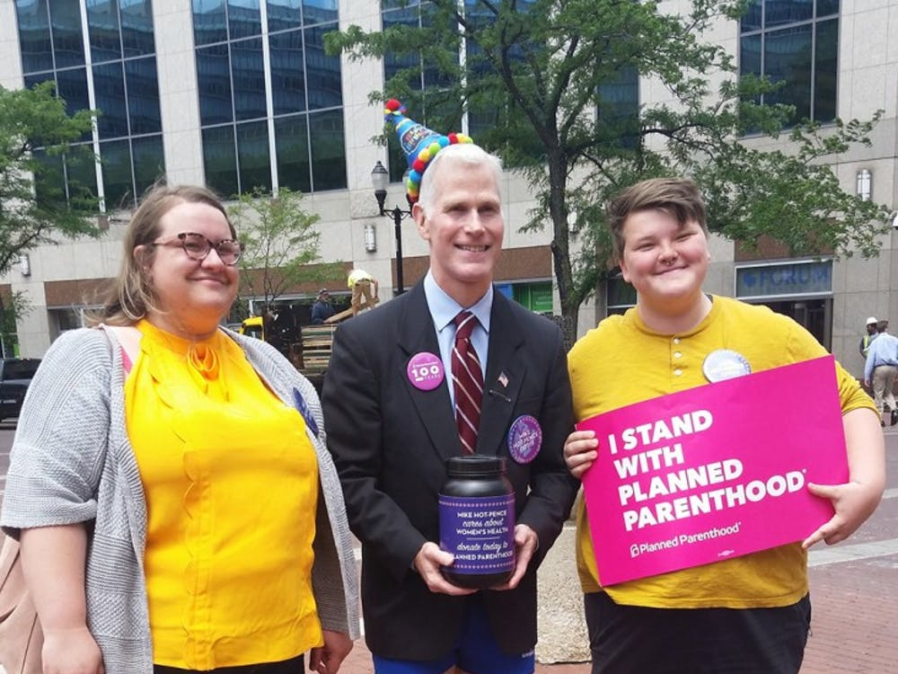Mike Hot-Pence, a Mike Pence impersonator, stands with Planned Parenthood supporters on Monument Circle in Indianapolis. Hot-Pence raised $1,500 for the organization at an event June 7.