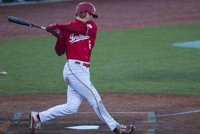 Sophomore Grant Richardson swings his bat March 7 at Bart Kaufman Field. Richardson led the team in batting average and was ranked first in the Big Ten in home runs, runs scored, slugging percentage and total bases last season.